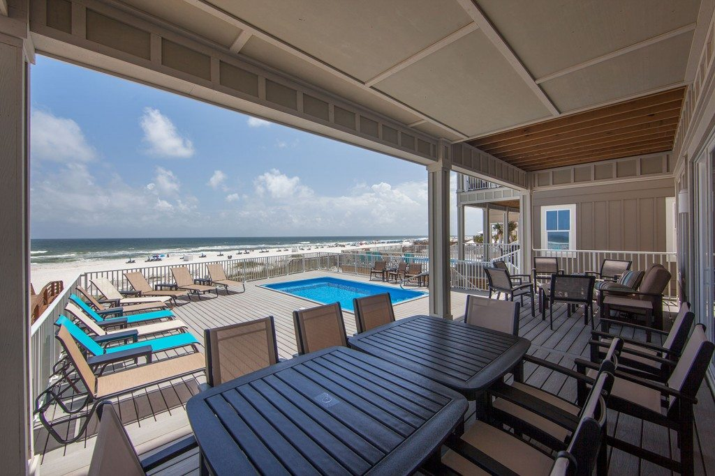 beach houses perfect for teams this image shows lots of poolside patio seating direct beach access