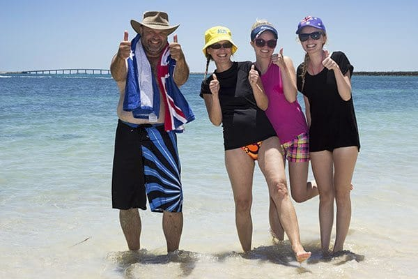 adults thumbs up on beach vacation home