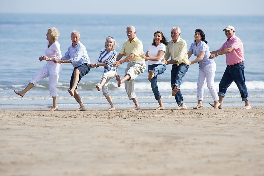 seniors dancing on the beach gulf shores vacation home